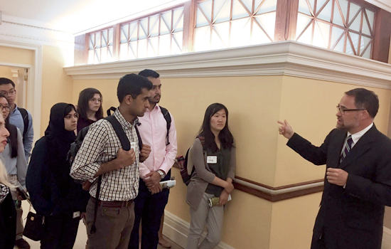Civic Digital Fellows listen in on a guided tour through the halls of the Library of Congress